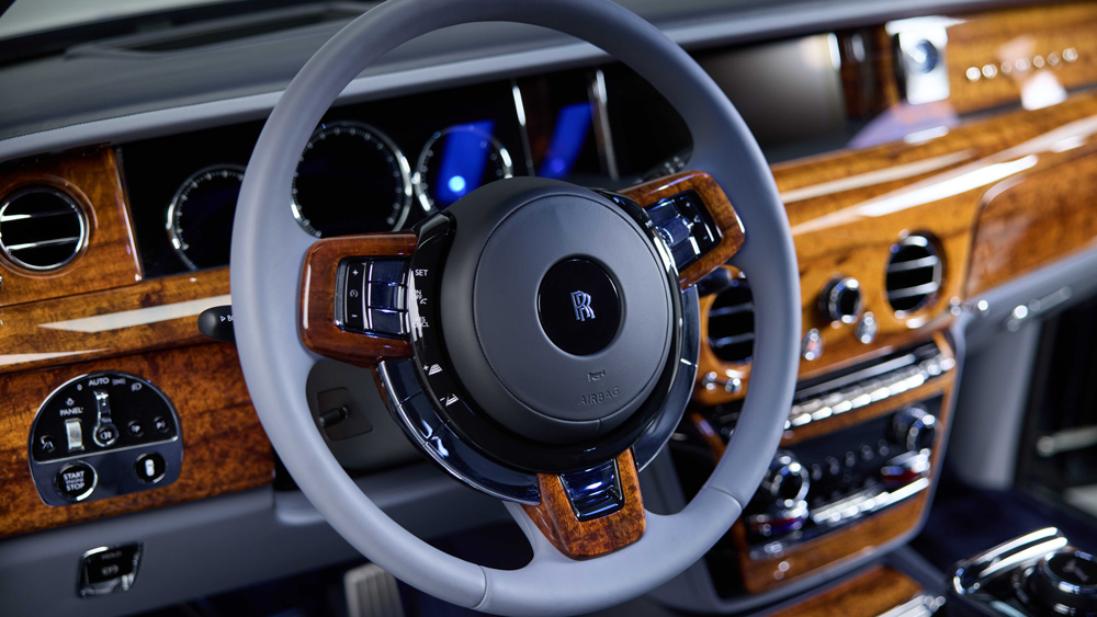 A bespoke Rolls-Royce Phantom with an interior that features Hawaiian Koa wood.