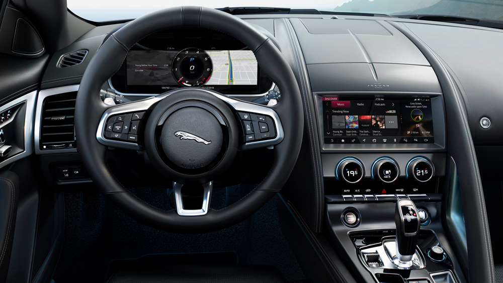 the view behind the wheel of a 2021 Jaguar F-Type R Coupe.