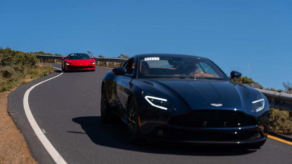 An Aston Martin and Ferrari take part in Robb Report's 2021 California Coastal road rally.